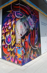 Festival Wall Art (Tomitheos) Tags: blue red portrait toronto ontario canada yellow corner graffiti flickr avatar picture optical pic daily photograph capture now today 2009 stockphotography orientalart rainbowcolors outdoorfestival  greatwalloffaces bytomitheos wallartinstallation