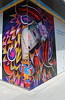 Festival Wall Art (Tomitheos) Tags: blue red portrait toronto ontario canada yellow corner graffiti flickr avatar picture optical pic daily photograph capture now today 2009 stockphotography orientalart rainbowcolors outdoorfestival φωτογραφία greatwalloffaces bytomitheos wallartinstallation