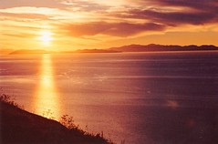 Sunset over the Marlborough Sounds (chris.bryant) Tags: ocean sunset sea newzealand sun sol water clouds atardecer islands agua afternoon calm hills views vista northisland southisland fabulous relaxation soe wmp cookstrait marlboroughsounds potofgold makara sunstreaks sillouhettes otw makarabeach abigfave landscapebeauty platinumphoto aplusphoto flickraward naturessilhouettes theperfectphotographer simplysuperb goldstaraward absolutelystunningscapes rubyphotographer panoramafotográfico artofimages saariysqualitypictures flickrclassique atomicaward expressyourselfaward exquisitesunsets