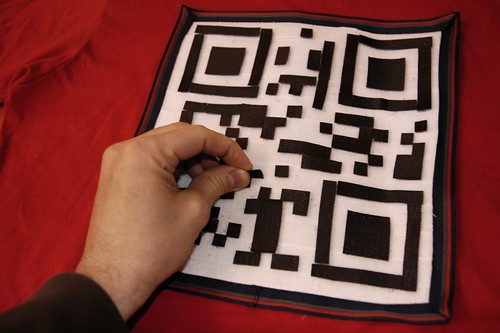 Reconfigurable QR code T-shirt by use of velcro