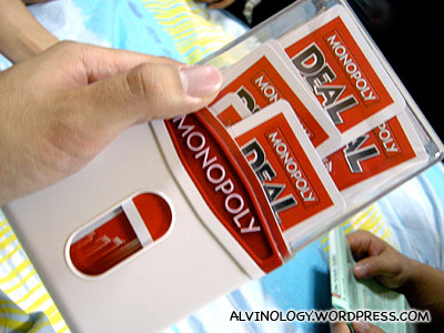 The cards are shuffled using this specially-designed plastic box