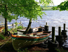 In the shade (magnum_lady) Tags: ireland lake water boats shade tyres sligo hazelwood loughgill mywinners theperfectphotographer