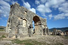 The Triumphal Arch (MykReeve) Tags: sky cloud stone clouds arch morocco triumphalarch volubilis المملكةالمغربية المغرب وليلي geo:lat=34074062 geo:lon=5555359
