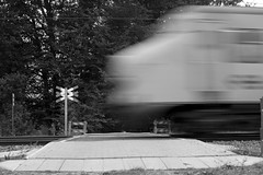 Train crossing a road (Dave Heuts) Tags: blackandwhite bw white david black dave train outdoors fantastic movement scenery stones scenic railway stunning zwart wit trein spoorwegen beweging daveheuts heuts