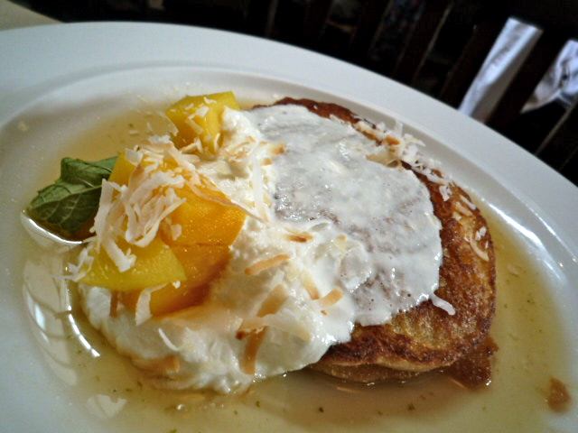 Coconut pancakes with fresh ricotta, mango salad and ginger-lime syrup