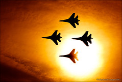 Squad of russian fighters Su-27 flying against the sun (Dmitry Mordolff) Tags: sunset sky orange sun clouds speed plane airplane outdoors flying team fighter order power russia aircraft aviation military air group flight jet aeroplane parade formation airshow vehicle squad airforce russian arrangement forces interceptor su27