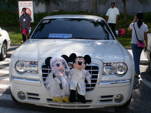 A bridal car with Mickey and Minnie Mouse in it adds a unique touch from the