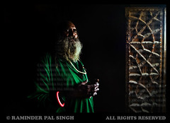 Baba Bhajna (Raminder Pal Singh) Tags: door light portrait india black green saint canon dark hair darkness ambientlight praying amritsar baba holyman villagelife attire prayerroom ancientbuilding canonphotography religiousman indiaimages naurangabad indianphotographer raminderpalsingh shottakenwithcanon raminderphotography bababhajna villagesaint standingindarkness