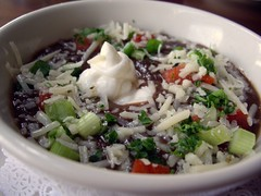 Cuban Black Bean Soup With Shaved Manchego, Fresh Crema, and Scallions