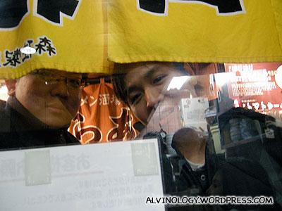 Mark and I peeking in from outside... lusting for Meiyen and Rachels ramens