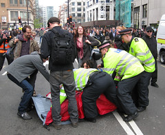 Flash Mob - First tent goes up (and down) - Bishopsgate Climate Protest (LensCop) Tags: london protest police tent financial bishopsgate aprilfoolsday g20meltdown climatecampinthecity