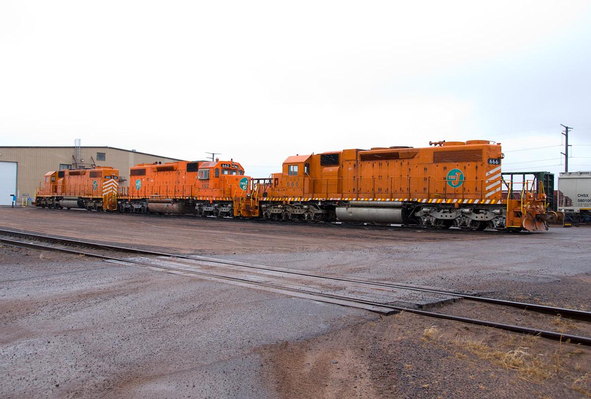 Three J SD38s at Pokegama