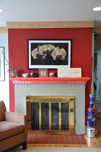 painting the mantel to offset the red wall