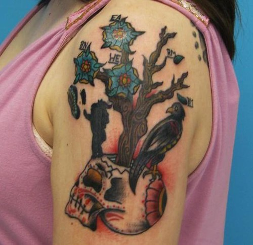 Freshly colored life/death tree tattoo.