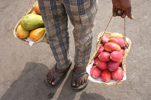 vendor selling papayas and mangoes