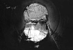 Drain Pipe, Factory Village Pond, Ashburnham, MA (shawndufour) Tags: blackandwhite abandoned alone decay pipe tunnel strangelight claustrophobia drainagepipe wetfeet ashburnhamma intensedarkandlight factoryvillagepond