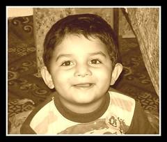 Mona Lisa Smile ([ RAFIQ ]) Tags: wallpaper portrait favorite baby cute beautiful smile kids portraits children kid interesting pretty background teeth innocent monalisa handsome lisa mona smug saudi smirk moment riyadh abdullah rafiq rafiqsa
