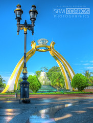The Crystal Arch at Jerudong Park :+: HDR (t2psalm) Tags: fountain playground photoshop canon lens gold interesting crystal roundabout explore noiseninja brunei hdr touristattraction photomatix flickrexplore crystalarch explored eos450d jerudongpark samcorros t2psalm rawtotiff explorebutnofrontpage