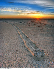 Crawling Stone ! (Jamal Alayoubi) Tags: blue sunset cloud stone racetrack death nikon track desert magic playa kuwait nikkor crawling d3 jamal sku 2470 alayoubi