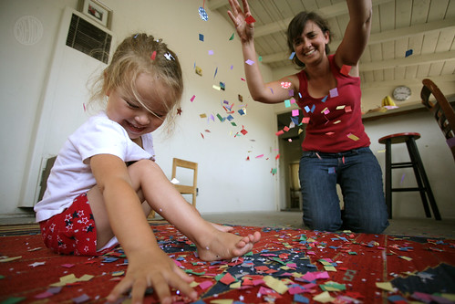 mom and child playing with confetti