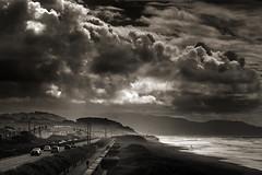 storming beach (louie imaging) Tags: ocean sf california sunset bw cliff white house storm black beach fog clouds canon lens zoo haze highway san francisco traffic mark great 5d local zuiko ll