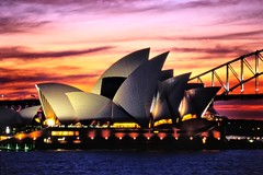 Australia - Sydney OperaHouse (Gianluca, very busy!) Tags: new trip travel bridge blue winter light sunset shadow red sea vacation sky orange cloud white holiday seascape color colour art heritage film water beautiful architecture night clouds reflections wonderful geotagged photography harbor photo opera bravo perfect colorful nuvole cityscape nuvola shadows image theatre harbour postcard sydney australia quay unesco worldheritagesite contax operahouse popular incredible colori breathtaking circular sydneyharbour ciccio royalbotanicgardens 135mm waterscape sonnar bennelongpoint sydneysymphony sydneytheatrecompany nightphotograpghy bestofaustralia newacademy qualitysurroundings theciccio gettyvacation2010