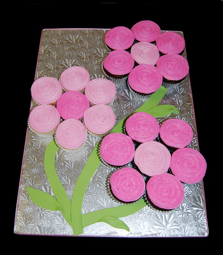 3 pink flowers made from cupcakes