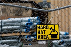 The Hat (Wolfman-K) Tags: ny hat sign electric fence construction power pipe cover damage conduit ziptie highfalls rge beebeestation photochallengeorg viapixelpipe 2009challenge brokenbump millstrochester 2009challenge112