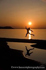 KAScott_20090503_4128b (Ken Scott) Tags: sunset usa beach silhouette jump michigan sleepingbeardunes voted sleepingbeardune leelanau pyramidpoint goodharbor sbdnl mostbeautifulplaceinamerica kenscottphotography kenscottphotographycom