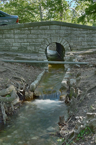 Tower Grove Park, in Saint Louis, Missouri, USA - bridge with watercourse and tunnel