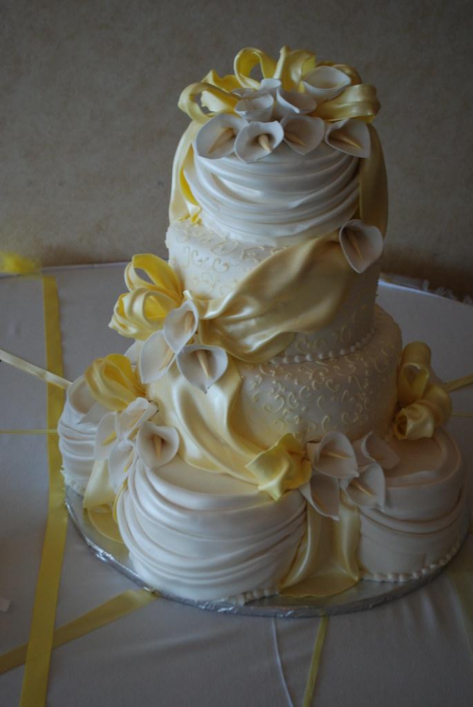 draped yellow wedding cake