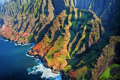 "Na Pali Coast aerial - Kauai, Hawaii #2 (IronRodArt - Royce Bair (""Star Shooter"")) Tags: ocean park travel blue sea vacation cliff holiday mountains green tourism nature water beautiful landscape island hawaii bay coast high colorful paradise pacific scenic dramatic wave peak landmark lookout canyon aerial na hills helicopter coastal shore kauai hawaiian tropical vista coastline peaks pali majestic untouched volcanic napali jurassic rugged steep"