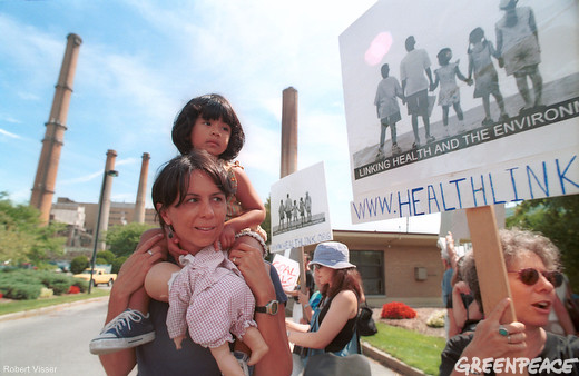 A mother and daughter protest the Salem Coal Plant