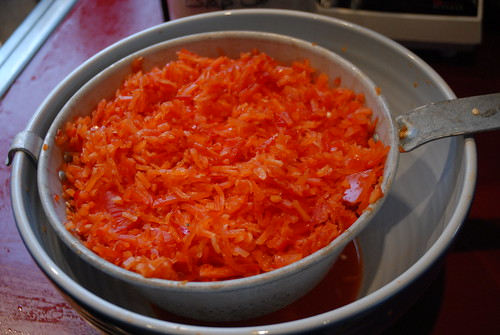 Draining the Red Bell Peppers once finely chopped