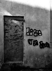 The well-locked door (PegaPPP) Tags: door light bw italy white black art wall concrete idea graffiti europe lock grunge security compo bn minimal blocked porta block locked bianco nero underexposed pega murato chiusa sicurezza sottoesposto