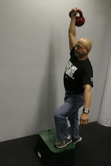 #7. Overhead: Kettlebell Step-Up.