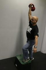 #7. Overhead: Kettlebell Step-Up.