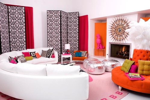 Barbie's happy white and orange family room, designed by Jonathan Adler, photos by Michael Williams/Haute Doll Magazine