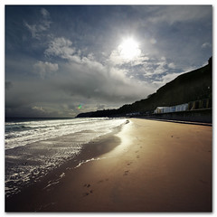 After the rain - Golden Sands ( Shanklin, Isle of Wight ) (s0ulsurfing) Tags: ocean wood light sea wild sky cliff cloud sunlight seascape beach nature water beauty weather clouds contrast square bay coast march wooden sand waves skies natural wind wide shoreline footprints fluffy wave wideangle ufo cliffs wash coastal filter shore foam cumulus flare getty coastline backlit humilis grad groyne beachhuts 2009 squared nube shanklin bold meteorology nephology 10mm wavelet sigma1020 nd4 sandownbay s0ulsurfing cumulushumilis aplusphoto vertorama eastwight