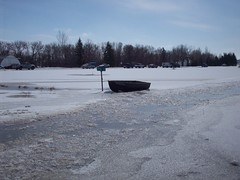 Our boat (legallyglinda) Tags: street sign flood rowboat tied 2009 westfargo sheyenneriver