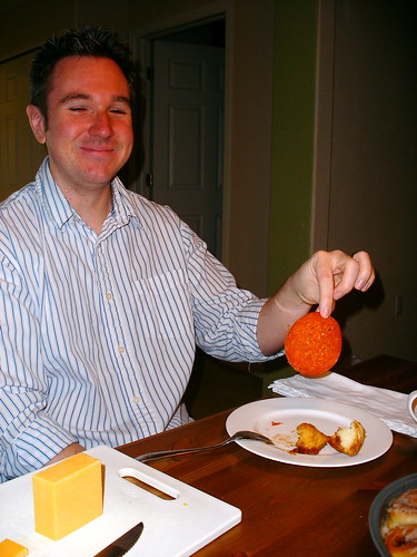 Brandon eats pepperoni with cinnamon rolls
