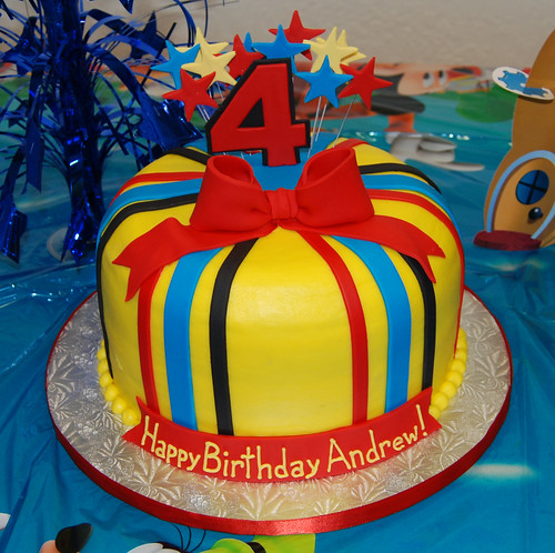 red black yellow and blue 4th birthday cake