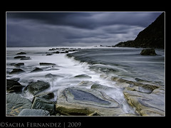 Forresters Beach - Cloudy and Stormy (sachman75) Tags: longexposure storm beach waves australia nsw centralcoast 1022mm cascadingwaters interestingness94 i500 ndgrad rockshelf forrestersbeach leefilters auselite canon40d snaptweet texturedrocks