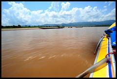 The Muddy Mekong River (NateVenture) Tags: travel hot water danger digital speed river thailand boat nikon speedboat wideangle adventure sunburn nikkor laos muddy luangprabang muggy humid chiangsaen chiangrai maesai photojornalism mekongriver uwa huayxai  1828  ultrawideangle chiangkhong afd 18mmf28d fastboat d700 1828d