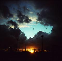 Gloaming (liquidnight) Tags: seattle trees sunset sky colour 120 clouds fence mediumformat holga twilight xpro streetlight kodak streetlamp bluesky slidefilm professional chainlink crossprocessing ektachrome gloaming holga120cfn 120cfn e100g justclouds