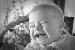 first smiles 2 (ian van johnson) Tags: portrait blackandwhite bw baby smile infant laugh directionallight