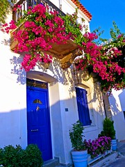 Balcony and bougainvillea (Marite2007) Tags: pink flowers summer house color nature colors architecture facade islands spring colorful pretty day outdoor balcony blossoms hellas bougainvillea greece ornament balconies colored cheerful saronic poros dwellings ellada vibrantblue