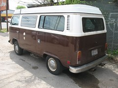 Brown and White Bay Window Campmobile in Austin, Texas - Driver Side Rear View