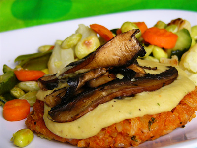 Rice patty with white bean sauce and mushrooms