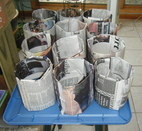 Using Newspaper to make pots.